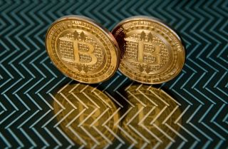 A pair of physical bitcoins, but the blockchain technology that powers the currency is far more important.