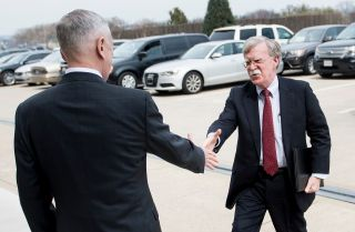 John Bolton, right, who is expected to take the helm as U.S. national security adviser on April 9, greets U.S. Secretary of Defense James Mattis outside the Pentagon.