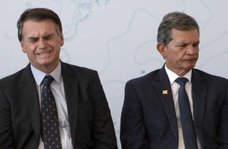 Brazilian President-elect Jair Bolsonaro (L) and Defense Minister General Joaquim Silva e Luna attend the launch ceremony of the Brazilian Riachuelo Class Submarine at a navy base in Itaguai city, Rio de Janeiro state, on Dec. 14, 2018.