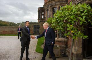 British Prime Minister Boris Johnson, right, greets his Irish counterpart, Leo Varadkar, on Oct. 10, 2019, in Liverpool, England.