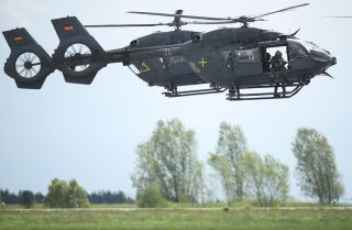 Germany's armed forces, the Bundeswehr, conduct a special forces simulation with two Airbus H145M helicopters at an air show in Schoenefeld, Germany, in April 2018.