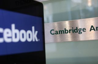 The Facebook logo appears on the screen of a laptop near the offices of Cambridge Analytica in London.