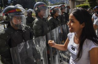 Members of the Bolivarian National Guard stand guard in Caracas