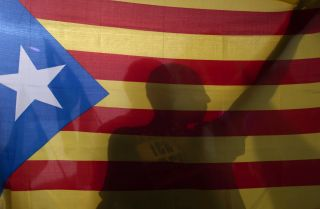 A protester in Granada, Spain, holds a Catalan flag to show his support for Catalonia's Oct. 1 independence referendum.
