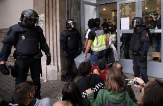 Spanish police seize ballot boxes in a polling station in Barcelona, on Oct. 1, 2017, on the day of a referendum on independence for Catalonia banned by Madrid. And after hundreds were injured in clashes on election day and voting was disrupted so thoroughly that results cannot be considered reliable, it's clear that things in the region will get worse before they get better.