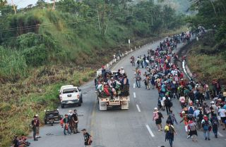 Central American migrants near Huixtla in the Mexican state of Chiapas head toward the United States more than 1,000 miles away on Oct. 24.
