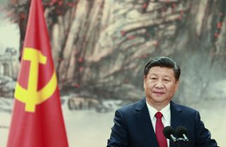 All signs suggest Chinese President Xi Jinping, shown here during the introduction of the Communist Party's new Politburo Standing Committee on Oct. 25, will be leading China for many years to come.