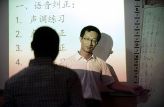 An instructor gives a lesson in Chinese language at a Confucius Institute in Lagos, Nigeria, in April 2016.