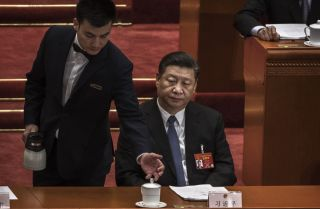 Chinese President Xi Jinping is served tea on March 12, 2019, during a session of the National People's Congress in Beijing.