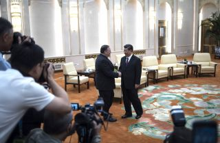 U.S. Secretary of State Mike Pompeo (L) shakes hands with Chinese President Xi Jinping during a meeting at the Great Hall of the People on June 14 in Beijing.