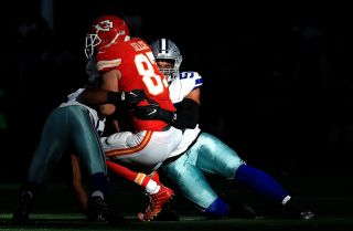 Dallas Cowboys player Damien Wilson tackles a member of the Kansas City Chiefs in a game in Arlington, Texas, on Nov. 5, 2017.