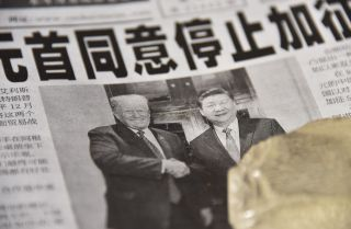 A Chinese newspaper on display at a newsstand in Beijing on Dec. 3, 2018, features a front-page story about the Group of 20 meeting between Chinese President Xi Jinping and U.S President Donald Trump in which the two leaders agreed to a trade truce.