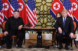U.S. President Donald Trump (R) holds a meeting with North Korean leader Kim Jong Un during the second U.S.-North Korea summit in Hanoi on Feb. 28, 2019.