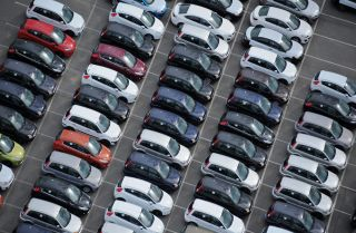 In this photograph, cars wait at port before passing through customs.