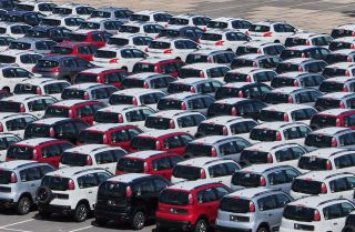 New Peugeot and Citroen cars await shipment on the pier in Rio de Janeiro, Brazil, in February 2017.
