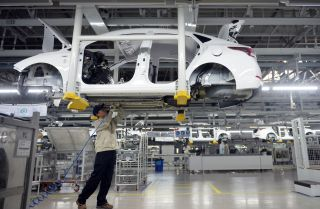 A worker assembles a vehicle in a Hyundai plant in China's Hebei province. South Korean automakers have increased their manufacturing capacity in China to  A significant proportion of South Korea's auto manufacturing capacity in China to 2.1 million vehicles annually.