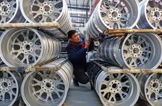 A Chinese worker checks wheels on Jan. 28, 2019, at a factory in Lianyungang, Jiangsu province.
