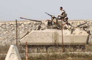 Egyptian troops patrol the border between the Gaza Strip and Egypt as they keep an eye on Hamas forces in 2016.