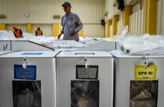 Officials prepare ballot boxes on April 16, 2019, in Jakarta, Indonesia.