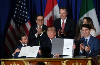 Mexican President Enrique Pena Nieto (left), U.S. President Donald Trump (center) and Canadian Prime Minister Justin Trudeau sit together after signing a new free trade agreement in Buenos Aires, Argentina, on Nov. 30.