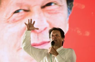 Pakistani cricket star-turned-politician Imran Khan speaks during a campaign rally in July 2018.
