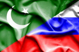 Waving Pakistani and Russian flags