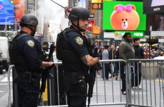 New York City police officers patrol Times Square on May 23, 2017, the morning after the Islamic State claimed responsibility for a suicide bombing at an Ariana Grande concert in the United Kingdom that killed 22 people.