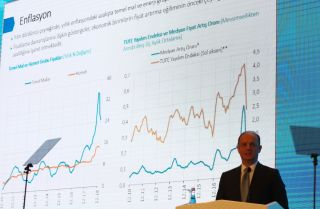 Turkish Central Bank Gov. Murat Cetinkaya delivers a speech in front of inflation graphs in Ankara on Jan. 30, 2019.