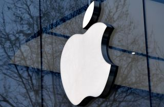 The logo for Apple Inc. adorns a storefront in the Belgian capital.