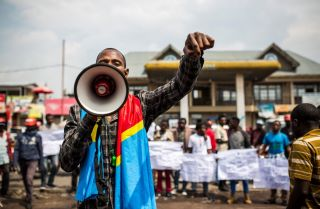 A supporter of the DRC's citizen movement speaks at a demonstration