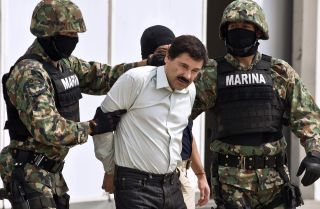 "Mexican drug trafficker Joaquin Guzman Loera, aka ""el Chapo Guzman"" (C), is presented to the press on Feb. 22, 2014 in Mexico City."