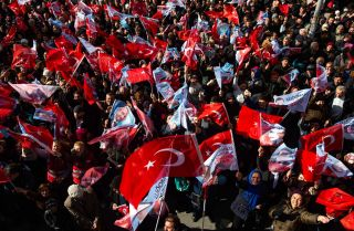 Supporters of the main opposition Republican People's Party's (CHP) mayoral candidate in Istanbul, Ekrem Imamoglu, wave flags during a rally ahead of upcoming local elections on March 29, 2019.