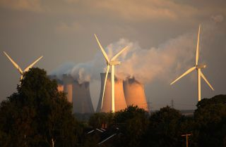 Wind turbines spin alongside the Drax power station, the biggest coal-fired plant in Europe.