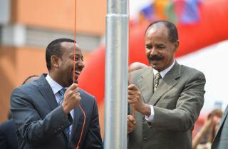 Abiy Ahmed (L), Ethiopia's prime minister, marks the reopening of the Eritrean Embassy in Addis Ababa on July 16, 2018, alongside Ertirea's president, Isaias Afwerki (R).
