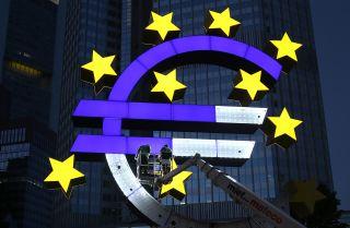 The Euro sculpture, built in 2001, undergoes restoration.