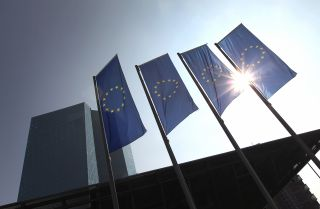 Banners of the European Union fly outside the European Central Bank headquarters in Frankfurt, Germany.