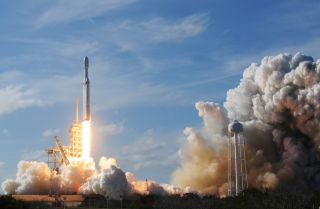 The Falcon Heavy, a fully reusable rocket from SpaceX, takes off from a launchpad at the Kennedy Space Center on Feb. 6, 2018.