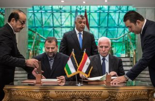 The leaders of Fatah and Hamas sign a reconciliation deal at the Egyptian intelligence services headquarters in Cairo on Oct. 12, ending their decadelong split.