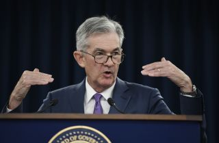 This image shows Jerome Powell, chairman of the U.S. Federal Reserve, delivering news about the central bank's decision to cut its benchmark interest rate.
