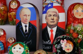 Russian matryoshka, or nesting, dolls depict Russian President Vladimir Putin and U.S. President Donald Trump.
