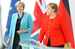 British Prime Minister Theresa May (left) and German Chancellor Angela Merkel meet for Brexit talks in Berlin during July 2018.