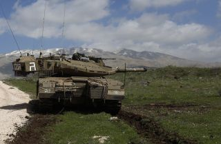 An Israeli army tank is stationed near the village of Majdal Shams, in the Israeli-annexed Golan Heights, on March 19, 2014.