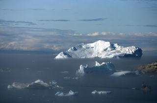 Icebergs float in the Jacobshavn Bay near the town of Ilulissat, Greenland.