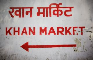 A sign displays the name of a New Delhi market in Hindi and English. A backlash has been building in India's non-Hindi-speaking south against the central government's efforts to promote Hindi as the national language.
