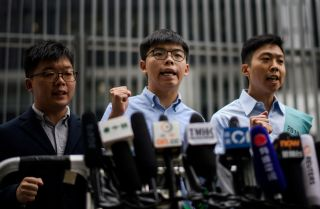 This photo shows Hong Kong pro-democracy activists Joshua Wong and Kelvin Lam protesting in front of the Legislative Council building after Wong was disqualified from running in district council elections.