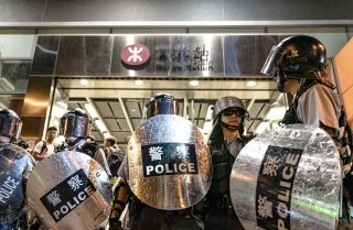 Police officers stand guard at Hong Kong's Po Lam Station during a standoff with protesters on Sept. 5, 2019.