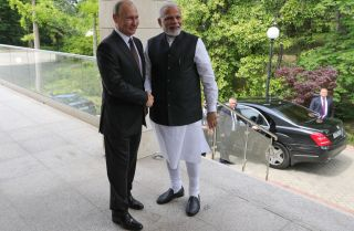 Russian President Vladimir Putin (left) welcomes Indian Prime Minister Narendra Modi during a meeting in Sochi on May 21.