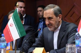 Iranian Supreme Leader Ayatollah Ali Khamenei's chief foreign policy adviser, Ali Akbar Velayati, oversees an agreement between the University of Aleppo in Syria and Iran's Islamic Azad University in November 2017. Syria is a key component in Iran's foreign policy strategy to extend its influence across the Arab world.
