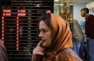 A woman walks past a currency exchange shop in the grand bazaar in Tehran, the capital of Iran, on Nov. 3, 2018.