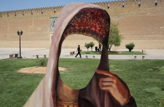 A cutout without a face stands in Karim Khan Castle in Shiraz, Iran.